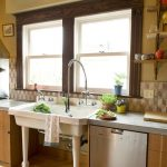 simple cottage style windows in kitchen with double hung model plus rich texture wood material in brown plus white frame