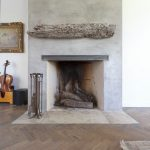 simple fireplace with driftwood mantle