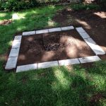 simple square underground fire pit with white brick frames