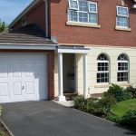 single garage door costco with solid hard wood in white color plus brick wall