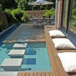Small Best Backyard Pools Withj Wood Floor And Family Living Space With Long Table And Cool Chair Plus Umbrella And Wood Fences