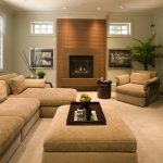 soft brown sectional sofa with single chaise a fireplace with natural brown mantel light grey color for walls light cream carpet floors