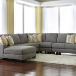soft grey double chaise sectional design with patterned soft cushions idea upon white furry area rug on wooden floor with yellow wall and floor to ceiling glass window