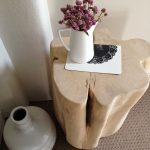 soft surface wood trunk side table in abstract shape and light cream tone color a white tea pot as flower vase a decorative porcelain vase