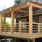 solid wood horizontal deck with big wood pillars and stairs