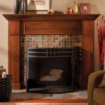 solidwood craftsman fireplace mantel with mosaic tiles surface a set of brown corner chair  a rattan basket for wood burning supplies