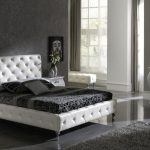 Stunning Black And White Bedroom Ideas With Modern Bed With Headboard Plus Gray Rug And Night Table With Drawer Plus Sideboard And Mirror And Wall Scones