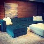 stunning blue velvet double chaise tufted sectional design with white cushions and white coffee table upn creamy furry rug beneath wooden deck wall and wall palette