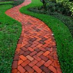 stunning brick paver patterns for garden pathways with herringbone pattern with color combination plus green grass and plants