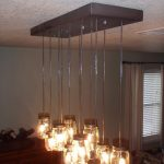 stunning can shaped alen and roth pendant lighting idea with wooden track and various length of transparent shade