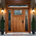 stunning wooden door design with pella storm door and pine trees and lantern and wooden casing and deck wall idea