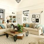 sweet cream luxurious living room design with rustic wooden coffee table upon joss main rug beneath vintage chandelier aside storage with wall palette
