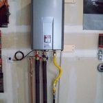 the installation of rinnai tankless water heater in wall with plumbing for easy hot water