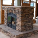 the outdoor two sided traditional fireplace with bricks frame