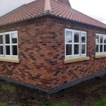 three units of cottage style windows with wood trims red and dark bricks for wall
