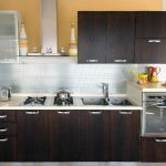 tiny kitchen remodel with dark kitchen cabinets plus countertops and sinks and oven with stylish backsplashes and glass wall mounted