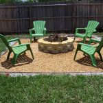 traditional in ground fire pit design of simple outdoor living space with green lawn chairs design with wooden fence and grassy meadow