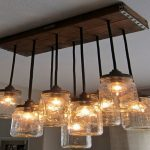 traditional short pendant idea of alen and roth lighting with wooden track and metal black poles and transparent shades