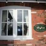 traditional window with trims for traditional cottage red bricks for cottage wall system