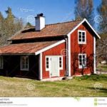 traditional wooden house with stupendous red painted exterior wall combined with white