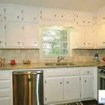 trendy white cabinet door feats with sleek stainless dishwasher oven stove and microwave in wellness kitchen remodel contractors