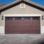 two cars garage door in maroon color from hard wood material plus door panel with window on top and stone floor