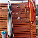 two types of outdoor shower heads a handheld shower head and wall mount shower head horizontal planks panels for shower space  half square shower rod curtain with ring clips vertical  stripes patterns s