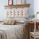 unique decorative headboard design with rustic wooden accent above the cream tufted bolster design with photo gallery with floral patterned bedding set