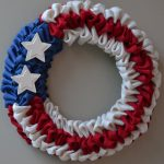unique fourth of july wreath design made of blue white red cloth braid with stars decoration