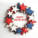 unique fourth of july wreath idea made of many stars in blue white and red colors with piling technique and happy fourth of july spelling
