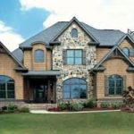 Unsettled Brown Painted House Ideas Combined With Rustic Stone Wall And Wonderful Landscape Design And Grey Able Roof