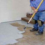 waterproof basement floor with epoxy paint in gray color scheme