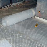 waterproofing basement floor with membrane installed at the back of perimeter drain