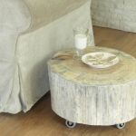 white wood painted tree trunk side table with wheels white sofa wood floors