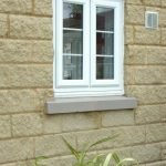window for cottage in whote trims fabricated bricks wall system