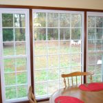 window replacement with picture windows plus glass and window frame and dining area with chandelier