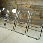 wonderful-cool-clean-clear-four-lucite-folding-chairs-with-nice-glassy-made-concept-with-black-frame-made-of-iron