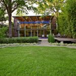 Better Homes and Gardens' landscaping idea with outdoor patio plus its furniture and a path constructed from natural stones floors