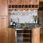 Corner wine bar for house with transparent glass door cabinet for storing the wine and wood cabinets plus shelves on top