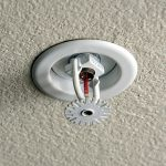 Fire sprinkler head installed on ceiling