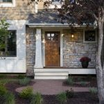 Fond du lac stones for exterior wall system a wood front door simple outdoor stairs a small porch without railing