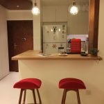 L shape and small corner kitchen bar with a pair of bar chairs with red seating feature a pair of pendant lighting fixtures