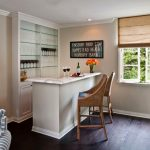L shape wine bar for home in white theme with rattan barstools