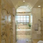 Large shower space with ceiling shower head fixture permanent shower bench permanent shelf shower fixture with multiple shower heads diamond cut shape tiles for wall