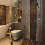 Luxurious bathroom with mix black and gold tone color floors for shower space and light grey tiles for wall beautified with black and gold tone tile a bathtub a floating closet in white