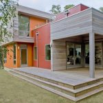 Modern minimalist energy efficient home design idea with bright colored home exterior