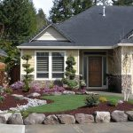 Simple front yard in a ranch home with big natural stones decorations
