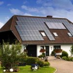 a construction for a private house with a lot of solar panels on roof as the source of natural energy