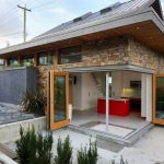 a low energy use house idea with open folding glass door