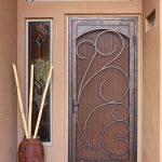 a security door with single sidelight feature but without door's transparent screen a decorative vase as the entrance area's decoration